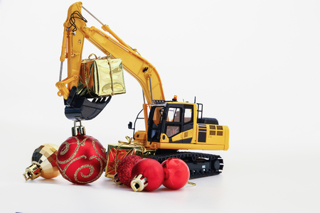 Christmas gift with  Excavator model ,  Holiday celebration concept new year on white background Banco de Imagens