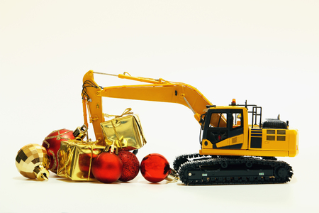 Christmas gift with  Excavator model ,  Holiday celebration concept new year on white background Stock Photo