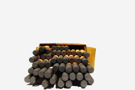 Gouging carbon electrode rods on white background Stock Photo