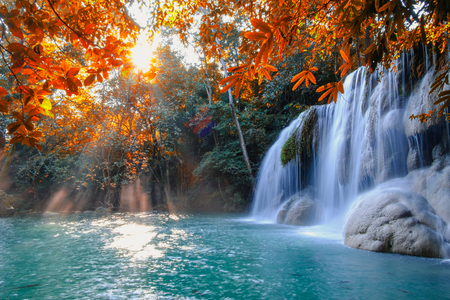 Scenic of nature Beautiful Waterfall with sunlight in autumn forest at Erawan  National Park, Thailand ,Travel amazing asia Stock Photo