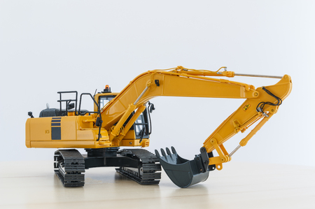 Excavator loader model on floor wood with white background
