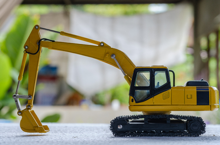 Excavator  model  toy on  blur background