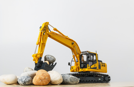 Excavator  model  with a stone lap in  bucket  lift up