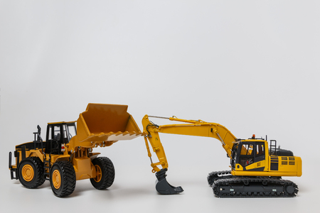 Excavator and Wheel loader model on white background Stock Photo