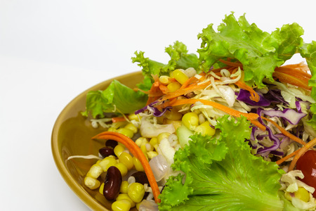 Salad of fresh vegetables and healthy grains in the dish. On a white background