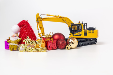 Christmas ornament and Excavator model Imagens - 113696496