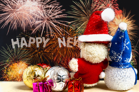 Christmas ornament and toy doll  on fireworks, New year celebration concept
