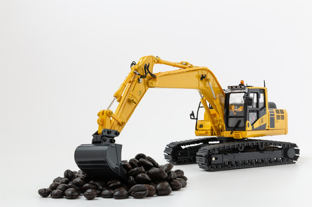 Roasted Coffee bean concept in scoop bucket of excavator loaders model
