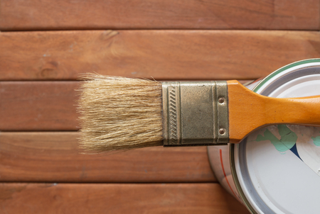 Paint  brush on can with wooden Standard-Bild - 121495769