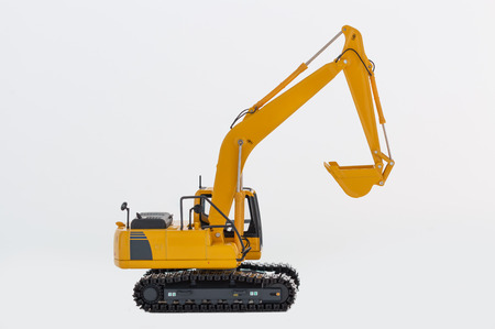 Yellow excavator loaders isolated on a white