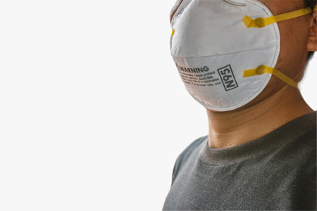 Man wearing facial  N95 Filter face mask,  Ecology, air pollution, Environmental ,dust and smoke welding protection with small Stock Photo