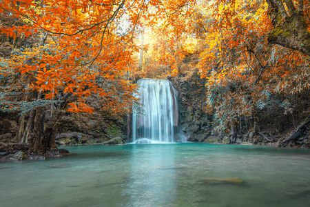 Scenic of nature with Beautiful Waterfall  in autumn forest at Erawan  National Park, Thailand Фото со стока