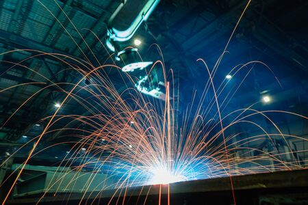 Welding Sparks from robot in manufacturing with blur focus