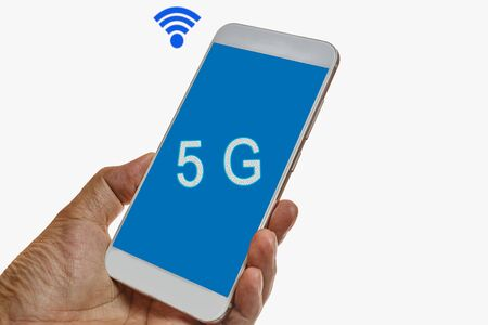 Hands holding mobile smartphone with 5G network standard communication on white