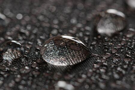 Water droplets on a black waterproof fabric Stock fotó