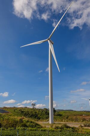 Wind turbines generating electricity with blue sky background,from wind power for environmental,Clean energy