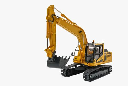 Yellow excavator model with isolated on a white background,Bucket lift up Standard-Bild