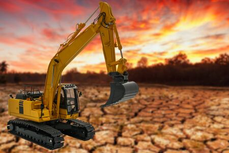 Excavators loader on the dry ground background,With light sunrise 스톡 콘텐츠