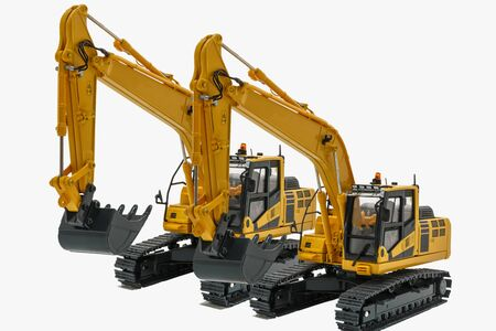 Two yellow excavator  model, machinery in heavy industry with isolated on white Archivio Fotografico