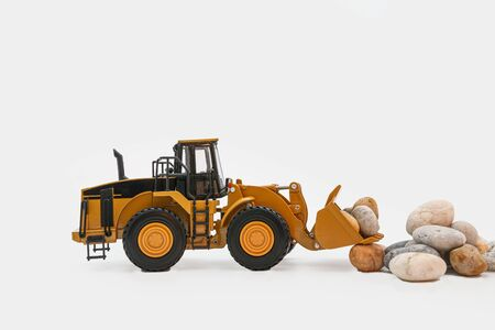 Wheel loader on white background ,With Stone scoop bucket lift up