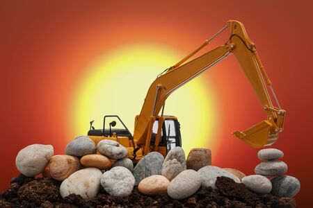 Excavators loader are digging the soil and stone in the construction site on the sun large size background 版權商用圖片