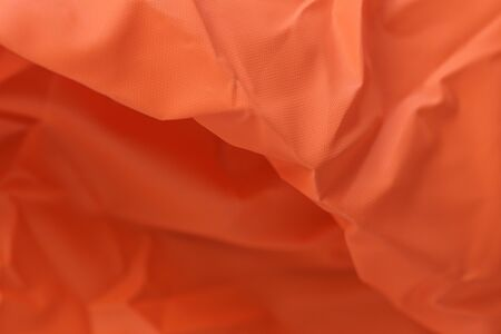 Macro photography,Texture abstract of bright orange fabric used as background