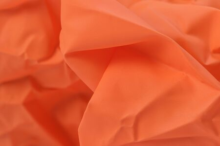Texture abstract of bright orange fabric