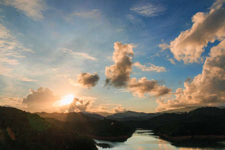 Dramatic sky orange with cloud and sunset background, Over the mountains and rivers
