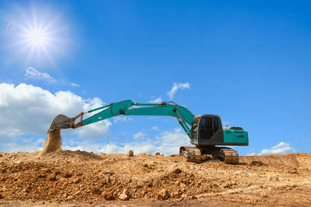 Crawler Excavators are digging the soil in the construction site Stock Photo