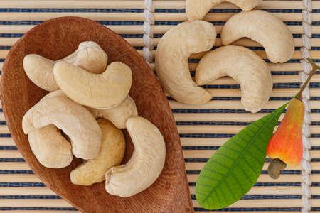 Ripe fruit with Cashew nut in spoon