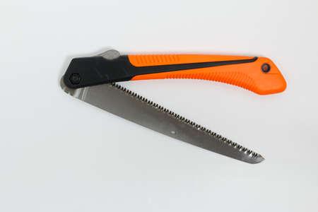 10-inch folding garden saw with orange handle 版權商用圖片