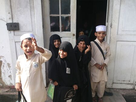 Young students infront of their class