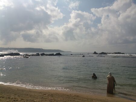 People swimming by the beach