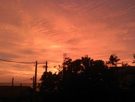 Sun setting in a town