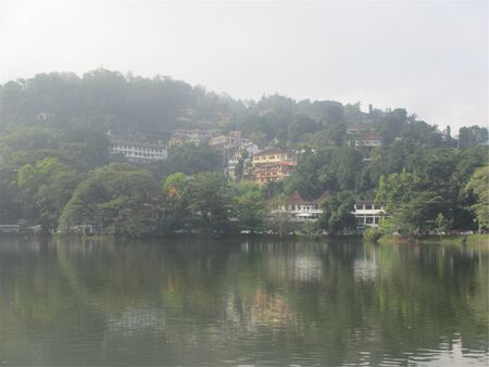 Buildings in the mountain by a lake Standard-Bild