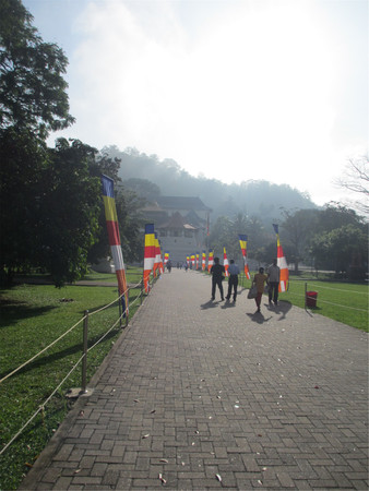 People walking towards Temple of the Tooth