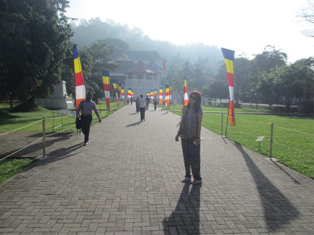People walking towards the temple of tooth