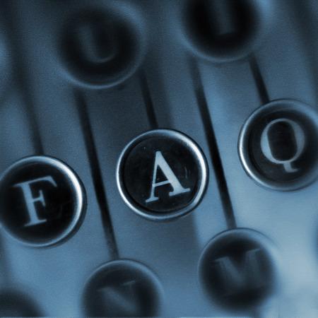 faq: FAQ word on the Vintage Typewriter.  Keyboard old typewriter with the word FAQ. Retro design element for web design.