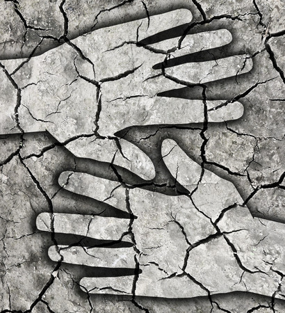 cracked: Dry thirsty land cracked earth. Dry brown cracked earth texture from dry lake with two hand silhouettes. Stock Photo
