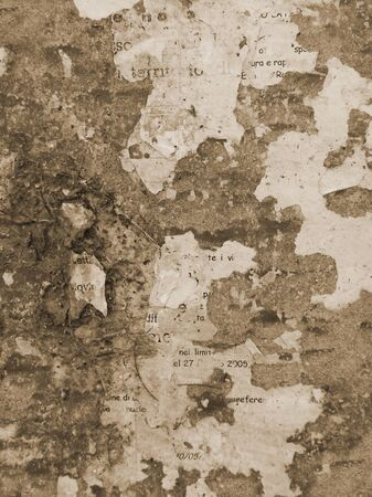 Grunge wall background. Brown colored grunge background with torn posters.