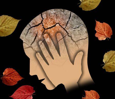 Otoño tristeza y depresión, joven. Silueta de cabeza masculina estilizada sosteniendo su cabeza Fotomontaje con tierra seca agrietada y hojas de otoño que simbolizan la depresión