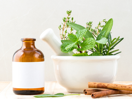 alternative health: Alternative health care fresh herbal and  Bottle of aromatherapy in mortar on wooden background.