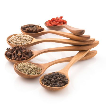 wooden insert: Spicy herb Insert a wooden spoon arranged to prepare food on a white background.