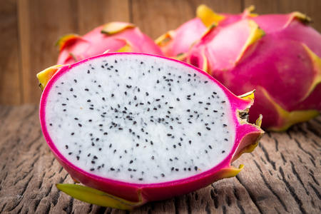 Dragon-fruits on wooden background.
