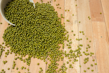 beansprouts: The mung beans on wooden surface Stock Photo