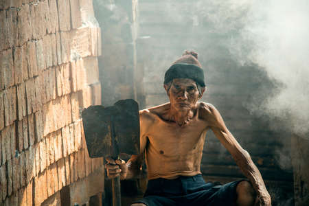 third world economy: Asia people work hard about construction in factory. Stock Photo