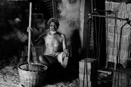 third world economy: Asia people smile after work hard about construction in factory.Black and White. Stock Photo