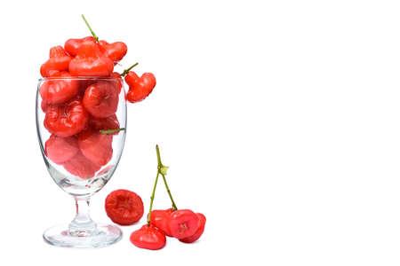 Rose apple, red fruit in the glass, isolate on white background