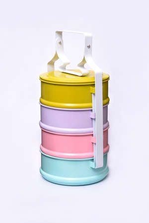 designed: Side view of colorful tiffin, food carrier isolate on white background Stock Photo