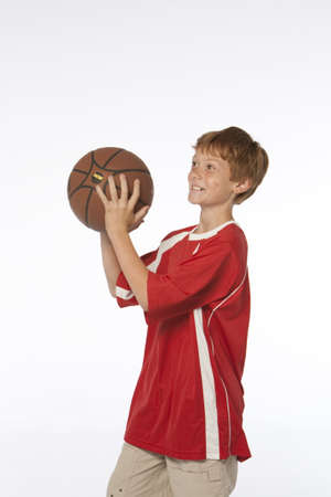 young man on white holding basketball Stock Photo - 5001302